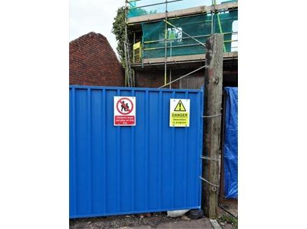 Danger Demolition in progress symbol and text safety sign.