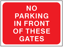 No parking in front of these gates temporary road sign.