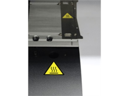 Hot surface warning symbol label.