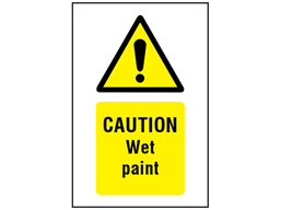 Caution Wet paint symbol and text safety sign.